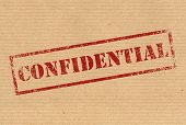 stock photo of personal safety  - Confidential red rubber ink stamp on karft paper texture - JPG