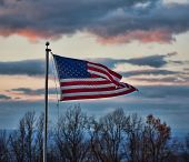 image of virginia  - American flag flying at dusk over the Blue Ridge in Virginia