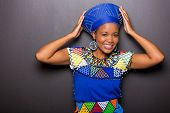 picture of traditional attire  - beautiful african model in traditional attire posing on black background - JPG
