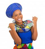 stock photo of traditional attire  - excited african girl in traditional clothes isolated on white - JPG