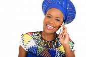 image of zulu  - pretty african zulu woman talking on smart phone isolated on white background - JPG