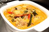 image of curry chicken  - A bowl of curry chicken cooked with coconut milk with chilli garnishing - JPG