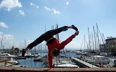 picture of do splits  - Man doing hanstand with the split at the port - JPG
