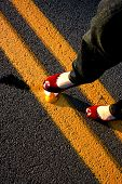 picture of stomp  - A stomping egg illusion with diagnol lines in the middle of the street - JPG