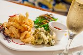stock photo of squid  - Salt and pepper squid with sauce and drink - JPG