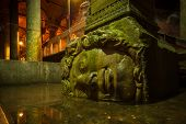 image of medusa  - A large Medusa head supports a column at the Basilica Cistern in Istanbul - JPG