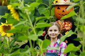 pic of scarecrow  - Scarecrow and happy girl  in the garden - JPG