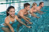 stock photo of day care center  - Fitness class doing aqua aerobics on exercise bikes in swimming pool at the leisure centre - JPG