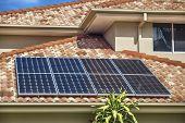 image of roof tile  - Solar panels on suburban Australian home roof - JPG
