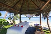 image of beach hut  - Massage hut with bed on tropical Fiji beach - JPG