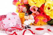 stock photo of fiance  - Colorful roses bride and fiance candle and gift box close up picture - JPG