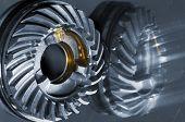 stock photo of titanium  - cogwheels with oil slicks mirrored in titanium - JPG