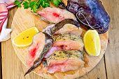stock photo of catfish  - Catfish raw sliced pieces on a circular board - JPG