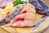 pic of catfish  - Catfish raw sliced pieces on a circular board - JPG
