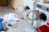 stock photo of dirty-laundry  - two big washing machines with the dirty laundry in the laundry room of the kindergarten - JPG
