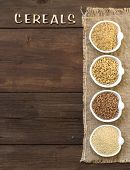 stock photo of cereal bowl  - Cereals in bowls border with word Cereals on wood - JPG