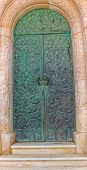 foto of mausoleum  - The bronze doors of the old mausoleum with a relief of an angels - JPG