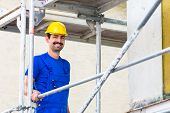 stock photo of scaffold  - Builder on construction site at scaffold - JPG