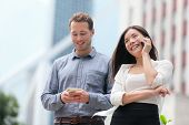 picture of people talking phone  - Young urban professionals business people on smartphones in Hong Kong - JPG