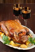 image of roast duck  - Roasted duck with quince mint and red wine on wooden background vertical - JPG