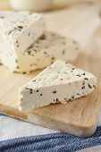 picture of cumin  - Cottage cheese with cumin on a rustic table - JPG
