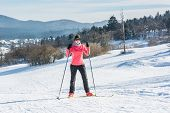 stock photo of ascending  - Cross country skier ascending a steep slope - JPG