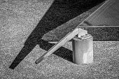 pic of metal sculpture  - Black and White photo of metal and concrete sculpture - JPG
