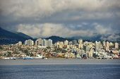 stock photo of cloudy  - North Vancouver city skyline across Vancouver Harbour in a cloudy day - JPG