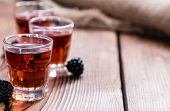stock photo of blackberries  - Blackberry Liqueur in a shot glass  - JPG