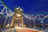 foto of london night  - Tower Bridge at night with the lights of the cars passing by shot in London United Kingdom England - JPG
