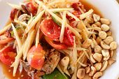 pic of green papaya salad  - Papaya salad in the dish on the table - JPG