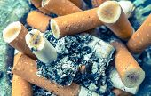 image of butts  - Cigarette butts at ashtray  - JPG