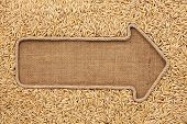 stock photo of sackcloth  - Pointer made from rope with grain oats lying on sackcloth with space for your text - JPG