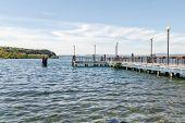 stock photo of jetties  - View of the jetty from the shore of Bracciano Lake  - JPG
