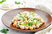picture of chickpea  - salad with chickpeas feta and parsley on a white background
