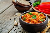 stock photo of millet  - millet porridge with tomato sauce garlic and parsley on a dark wood background - JPG