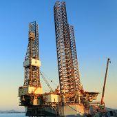 image of shipyard  - Jack up oil drilling rig in the shipyard for maintenance - JPG