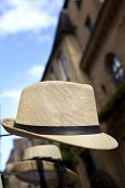 image of stall  - Straw hat on a market stall in town - JPG