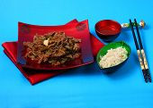 image of stir fry  - Vietnamese beef stir fry served on a blue background - JPG