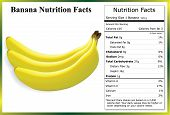 stock photo of banana  - Clump of bananas with a nutrition label containing the nutrients in one banana - JPG