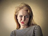 stock photo of disgusting  - Disgusted woman - JPG