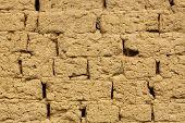 image of mud  - horizontal image of old mud brick wall - JPG