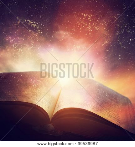 Open old book merged with magic galaxy sky, universe, stars. Concept of literature, fantasy, horosco