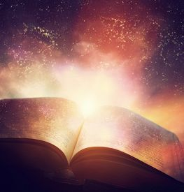 image of merge  - Open old book merged with magic galaxy sky - JPG