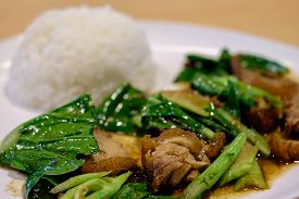 picture of crispy rice  - Stir fried kale with crispy pork and steamed rice in Thai restaurant - JPG