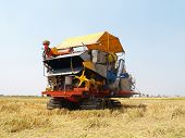 stock photo of farmworker  - agriculture machine at the rice farm in Thailand - JPG
