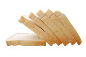 foto of fresh slice bread  - nutritious slices of white bread isolated over white macro copyspace - JPG