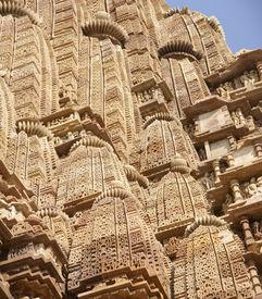 stock photo of kandariya mahadeva temple  - Shikara tower geometric decorations Kandariya Mahadeva Temple at Khajuraho India - JPG