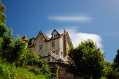 Country House With Green Garden In The Region Of Normandy, France On A Sunny Day. Beautiful Countrys poster
