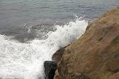 Mediterranean Sea Waves Crash Against Coastal Rock poster